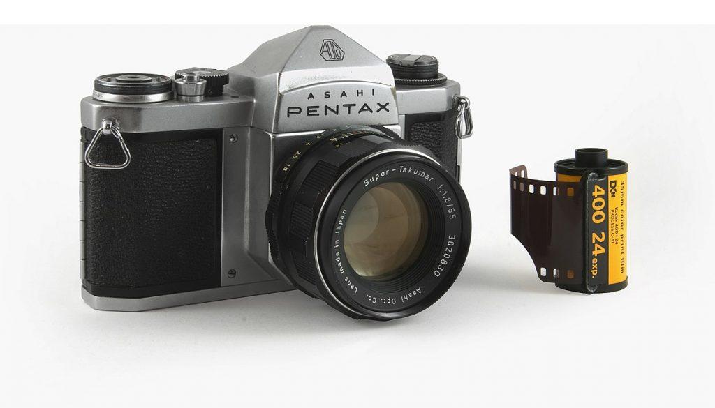 Kodak 35mm film cartridge alongside Asahi Pentax film camera | By Bilby